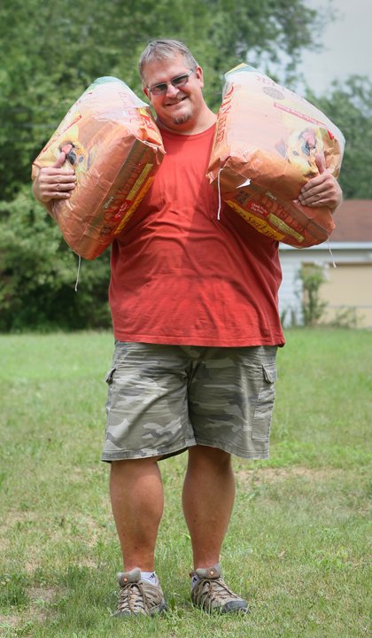 Me And Two 50 Pound Bags Of Dog Food Equaling My Weight Loss Total